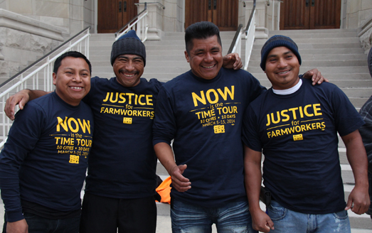 CIW members model their tour gear in front of Dilworth Methodist Church