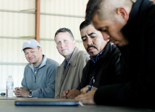 Walmart (left), CIW representatives (right) sign historic agreement at a Lipman Produce farm