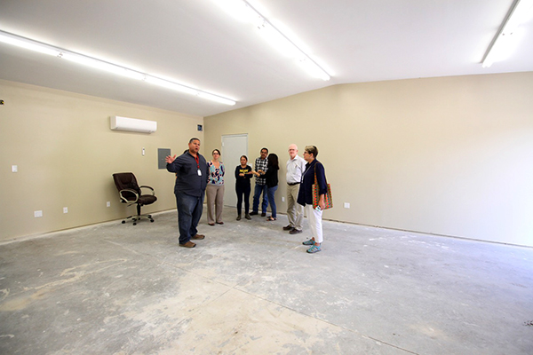 Rev. Edmiston receiving a tour of Sunripe Certified Tomato's new, in-progress training facility – tailored specifically to host the worker-to-worker education sessions farmworkers receive as part of the Fair Food Program.