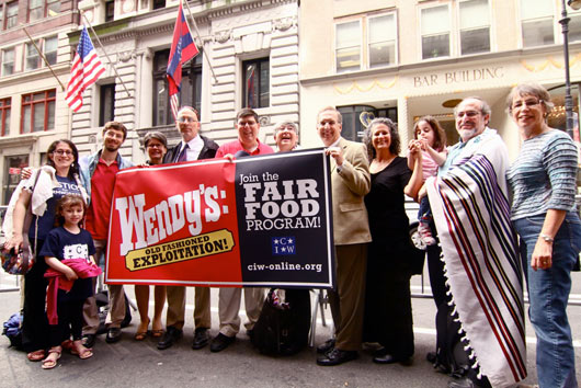 Tomato Rabbis outside of Wendy's shareholder meeting in 2013