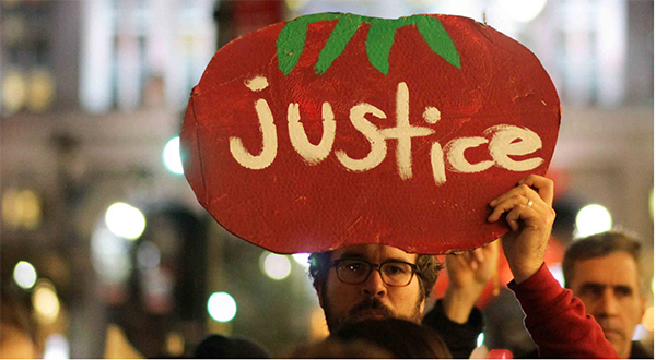 Fair Food allies march with farmworkers in New York to the office of Wendy's Board Chairman, Nelson Peltz