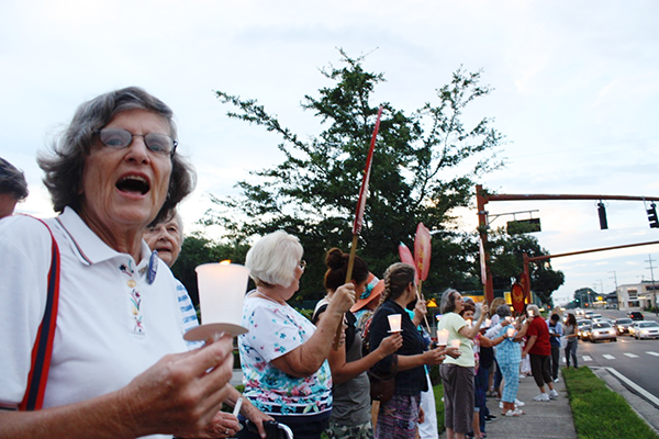 United Methodist Women hold a powerful 70-person vigil outside a Publix store in Lakeland during their gathering in the summer of 2013