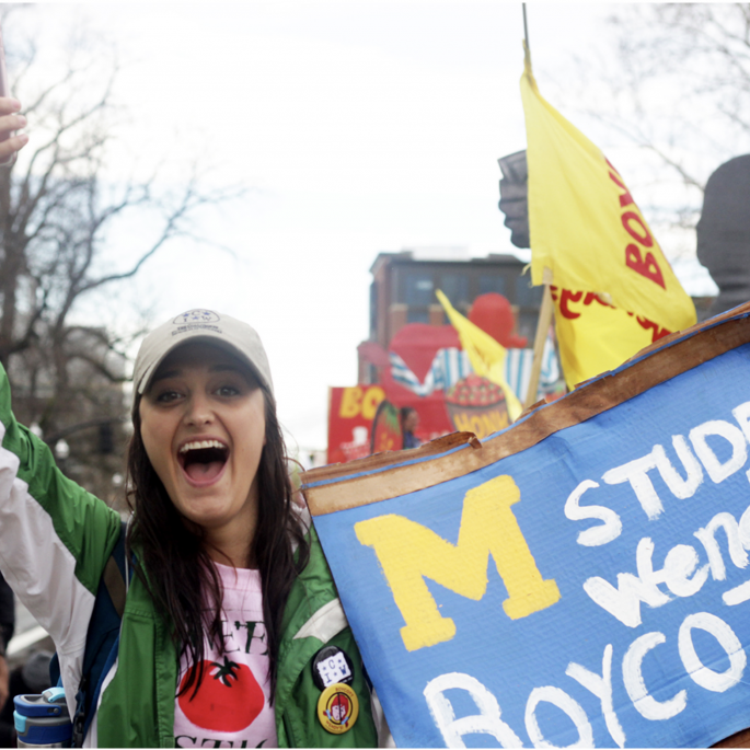 University of Michigan student marching in the 2017 Fair Food Parade in Columbus, Ohio.