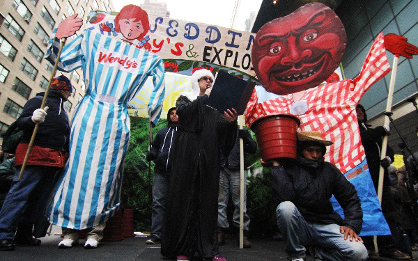 CIW's theater piece, complete with 9-ft puppets, concluded with a call to boycott the world's third largest hamburger chain.