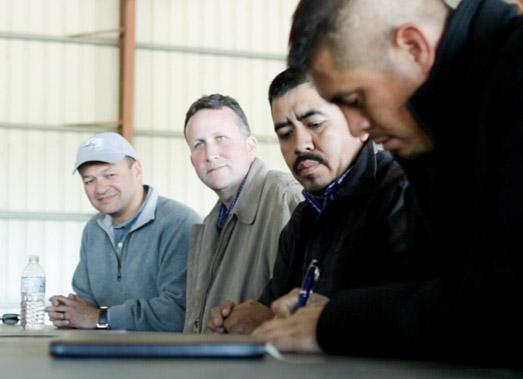 Walmart (left), CIW representatives (right) sign historic agreement at a Lipman Produce farm