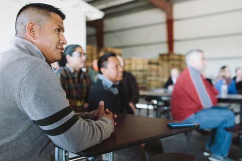 CIW members, Walmart representatives look on during last week's signing ceremony.