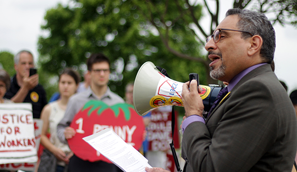 Tony de la Rosa, Interim Executive Director of the Presbyterian Mission Agency, speaking to crowds at last month's massive protest in front of the Wendy's shareholder meeting