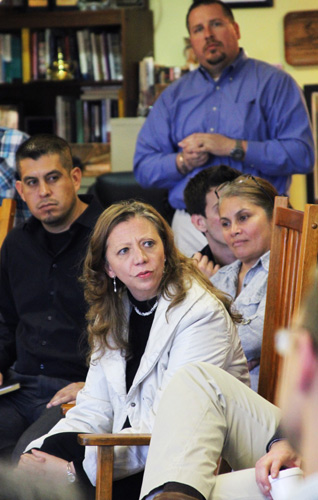 Alexandra Guaqueta (center), Chairwoman of the UN's Working Group on Business and Human Rights, listens during last week's meeting at CIW headquarters.