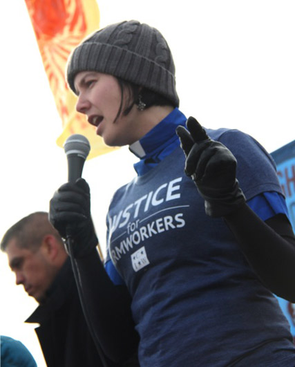 Rev. April Blaine speaking at a rally in front of Wendy's headquarters in 2014
