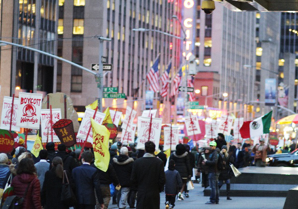 500 _______ march past Radio City on their way to the offices of Wendy's Board Chairman Nelson Peltz