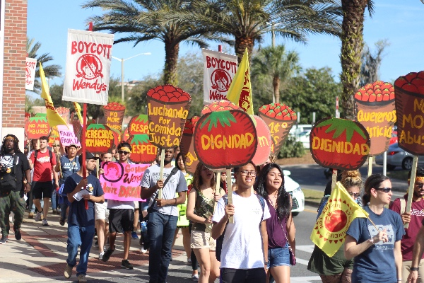 Students at the University of Florida join farmworkers for a march through campus during the Workers' Voice Tour stop in Gainesville, Florida