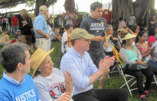 Ethel Kennedy (center), widow of Robert Kennedy, sits with grandson-in-law, Liam Kerr (left) and the Rev. Matt Malone a Jesuit priest, after Saturday's march.